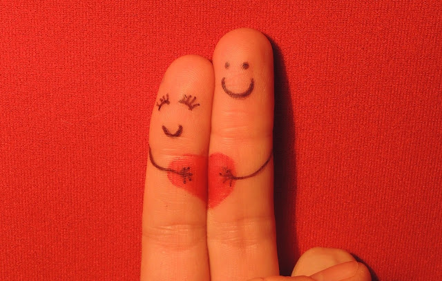 2 fingers with a smiley face