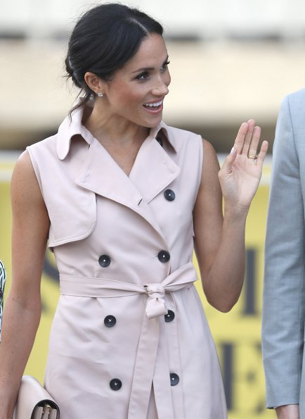 Meghan Markle wore Nonie trench coat from the Nonie SS18 collection. Canadian-based luxury fashion label. Mulberry Handbag, Dior Shoes