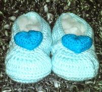 http://crocheteandoconimaginacion.blogspot.com.es/2014/07/zapatitos-princesas-cenicienta-y-aurora.html