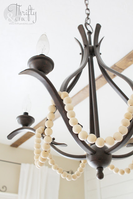 DIY Farmhouse chandelier. Change any chandelier into a farmhouse chandelier. How to makeover your chandelier. Farmhouse decor and decorating ideas. Dining room decor. Dining room chandelier.