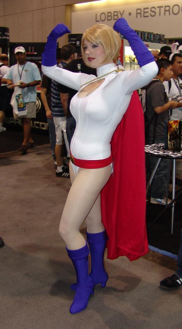 power girl posing with raised arms