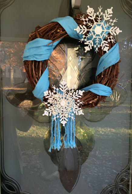 Use a scarf and dollar tree ornaments to make this Winter Snowflake Grapevine Wreath!