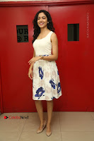 Actress Ritu Varma Stills in White Floral Short Dress at Kesava Movie Success Meet .COM 0019.JPG