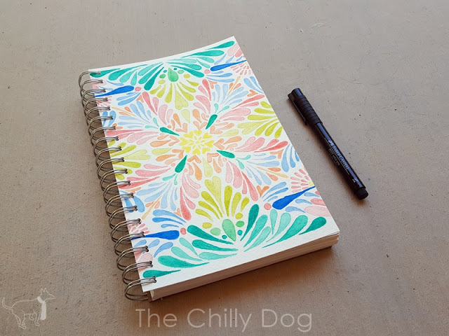 How to personalize a sketchbook or journal cover with recycled artwork or cardboard.