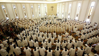 Prelates attend a mass celebrated in the Legion of Christ main headquarters, the Ateneo Pontificio Regina Apostolorum, in Rome, Feb. 25, 2014. The rector of the seminary in Rome has left the priesthood after fathering two children.
