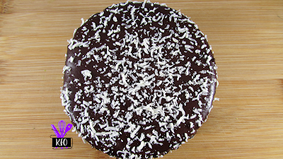chocolate crust, creamy chocolate cheesecake base, and covered in chocolate. with white chocolate shaved on top