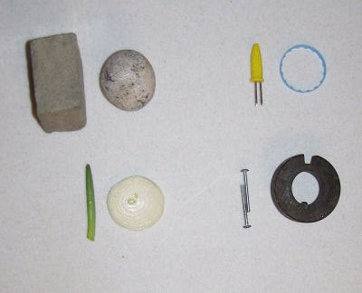four examples of the number 10 made with common objects