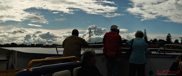 Clouds and river view from city cat ferry, Bulimba reach. Photo by Kent Johnson.