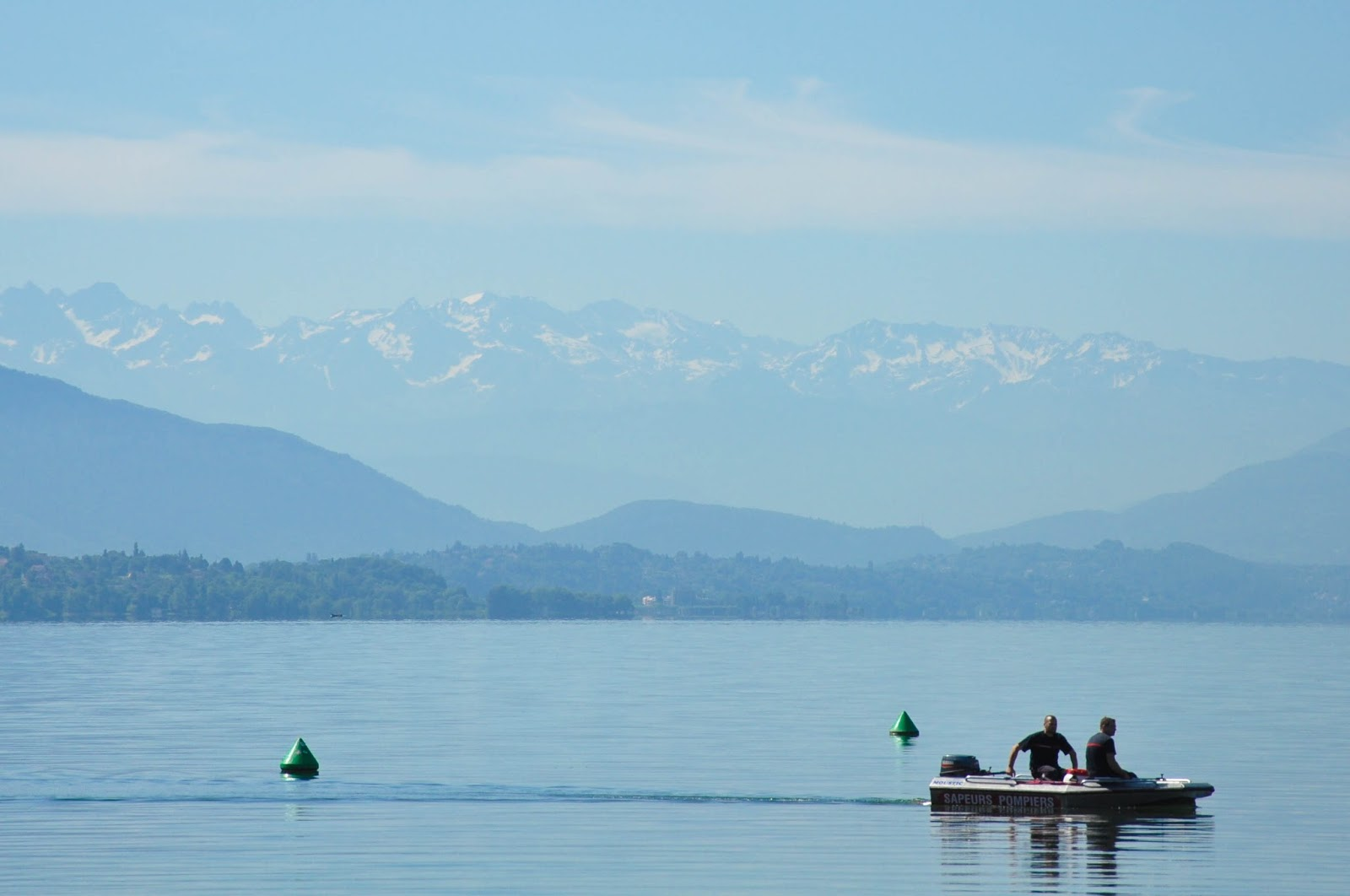 A boat gliding on Lake Bourget, France's largest lake