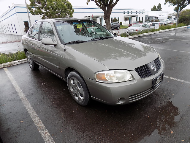 2004 Nissan Sentra with fresh overall paint job from Almost Everything Auto Body.