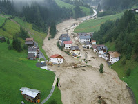 An August 2005 flood tearing through Tirol, Austria. (Credit: ASI/Land Tirol/BH Landeck) Click to Enlarge.