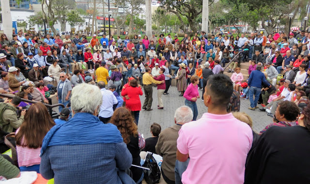 Local people gathering to dance in Parque Kennedy, a popular thing to do in the Miraflores district of Lima Peru