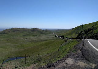 View to the east of wind turbines and green hills from the summit of Patterson Pass Road, Livermore, California