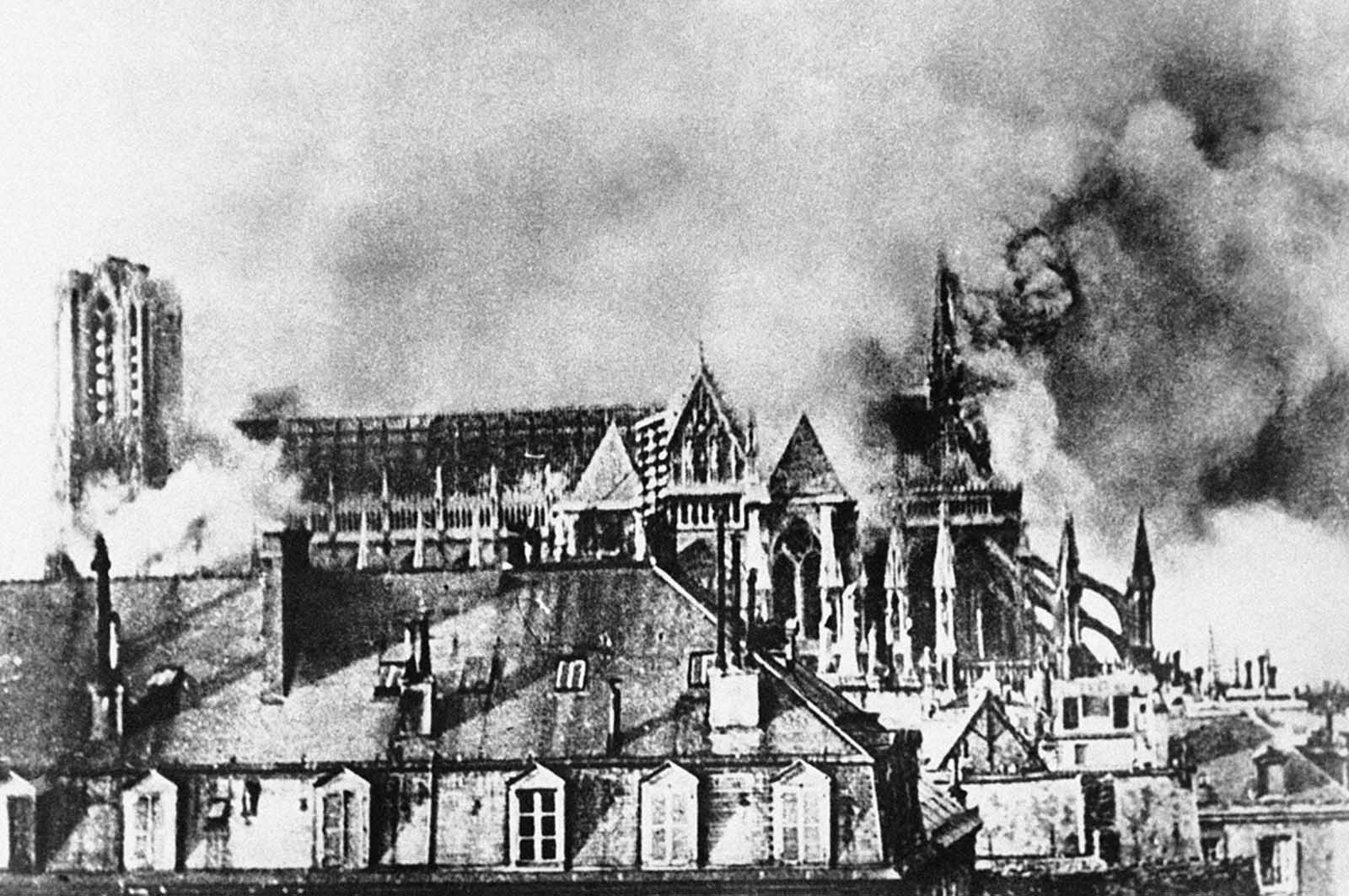 Bombardment of the Cathedral of Reims, France, in September of 1914, as German incendiary bombs fell on the towers and on the apse during the German invasion of northern France.
