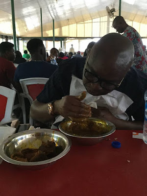 Image result for See governor Fayose eating Amala at a local joint in Abuja