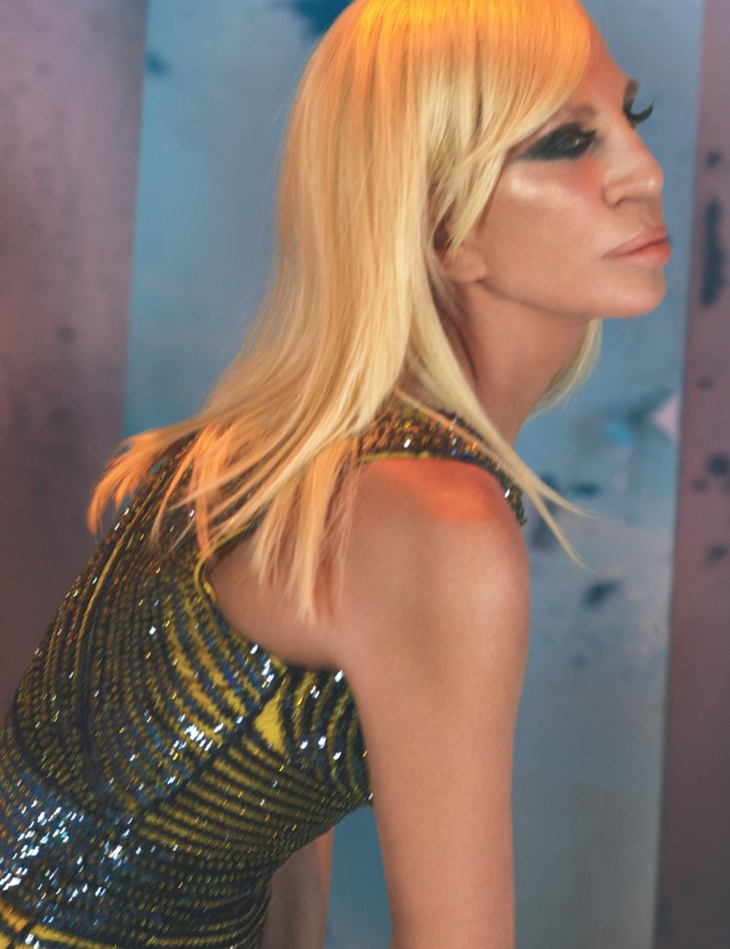 Donatella Versace poses in glittering Versace dress