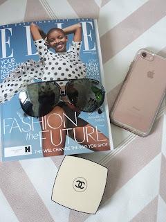 porsche p8478 sunglasses flatlay with elle mag