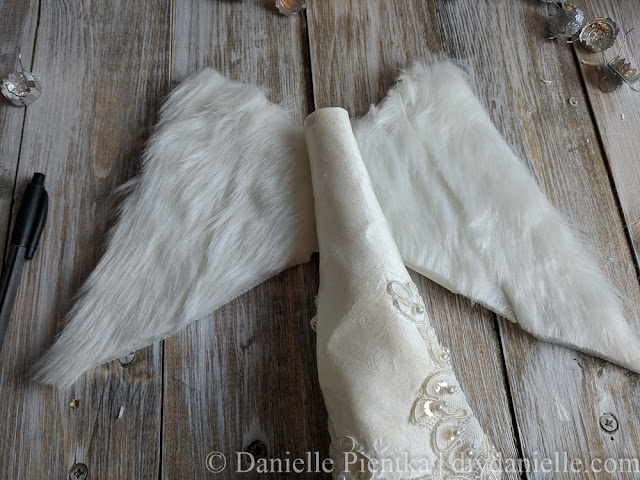 Gluing on the wings for the angel.