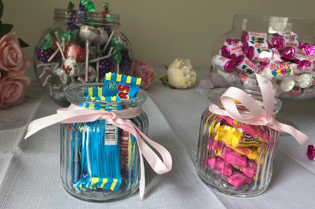 love hearts, lollies and refresher sweets in jars