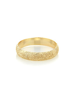 This sparkly number is 50% off at the moment for £145.00. I love wearing a plain band with a twist and this textured ring gives a beautiful effect without the addition of precious stones making this ring more affordable but just as luxurious.