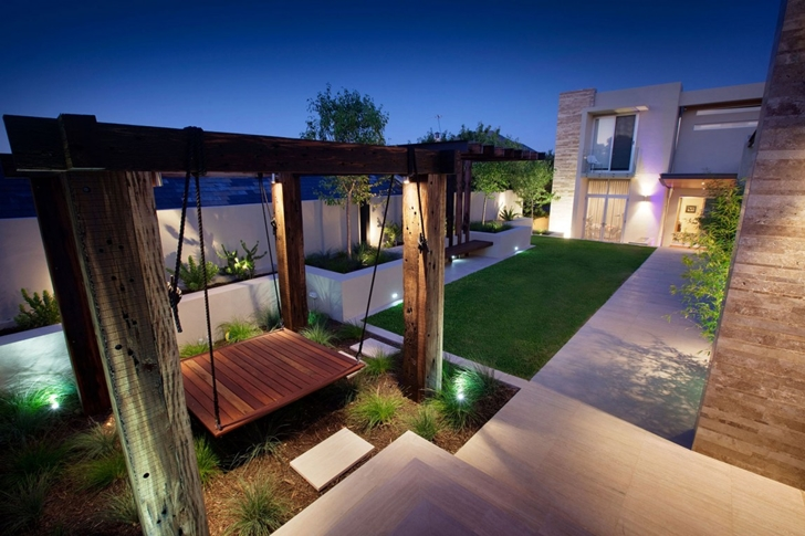 Swing in the Modern backyard by Ritz Exterior Design