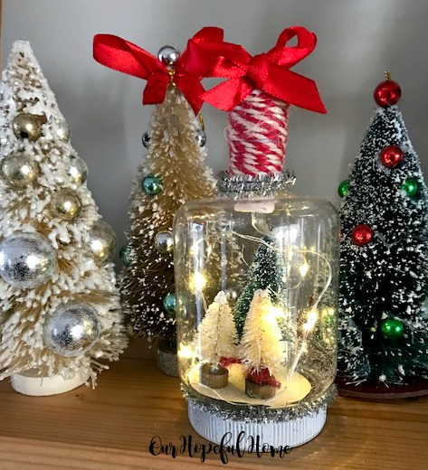 ornament snow globe bottle brush trees tinsel