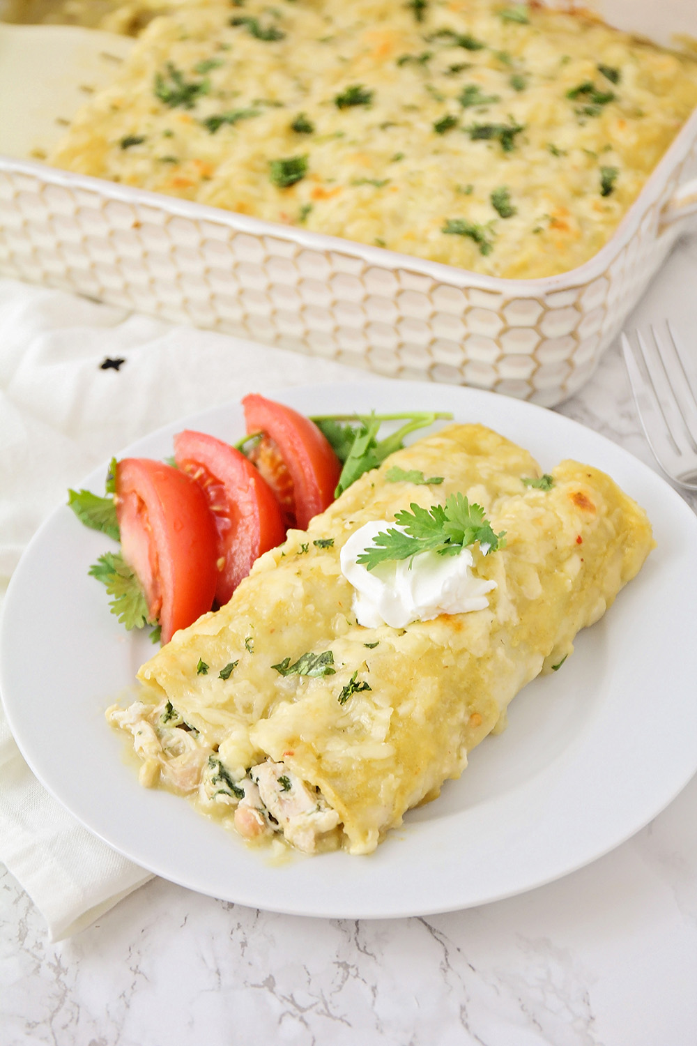 These creamy and savory green chili chicken enchiladas are so delicious, and so easy to make!