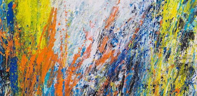 orange, yellow, blue, black and white, painted vertically like tree bark