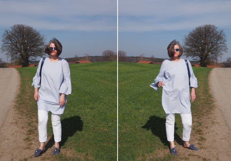Longbluse mit feinen blauen Steifen zur weißen Jeans kombiniert