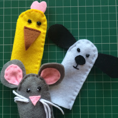 Felt animal finger puppets of a dog, mouse and chicken