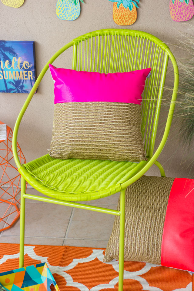 Love this bright green chair and hot pink pillow from At Home stores!