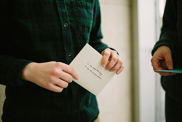 Exchanging letters the morning of our wedding | Photography by Jessica Holleque