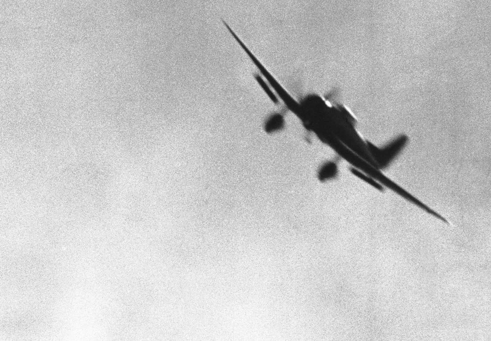 A Japanese bomber, its diving flaps down, was photographed by a U.S. Navy photographer as the plane approached its Pearl Harbor objective on December 7.