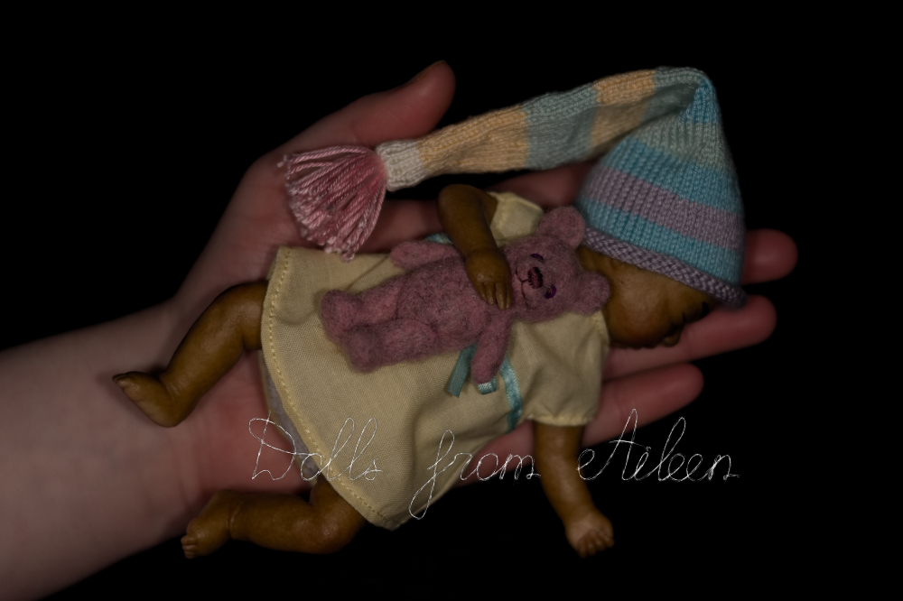 ooak sleeping mini baby girl doll on human hand