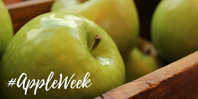 picture of crate of apples with #appleweek logo on it