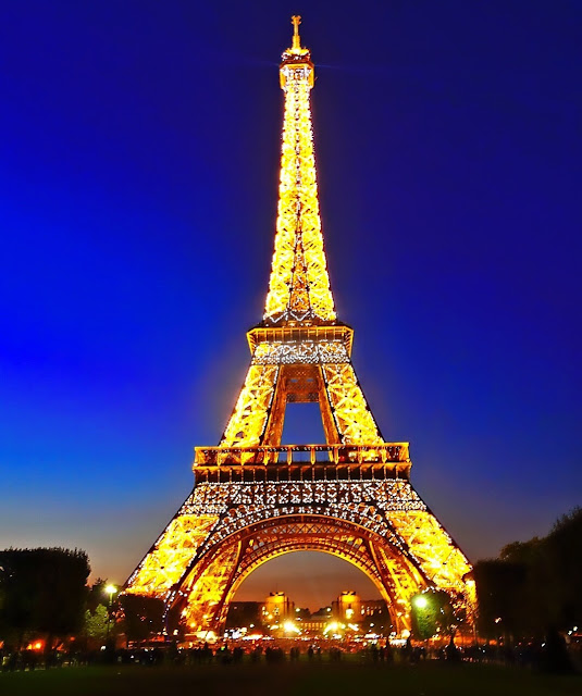 Eiffel Tower light show - the tower sparkles every hour after sunset for 5 minutes - don't miss this!