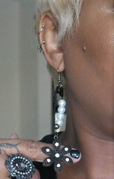 Image: Woman is showing off her DIY safety pin earrings as inspiration. Seen first on Bits and Babbles #funkyfridaydiy