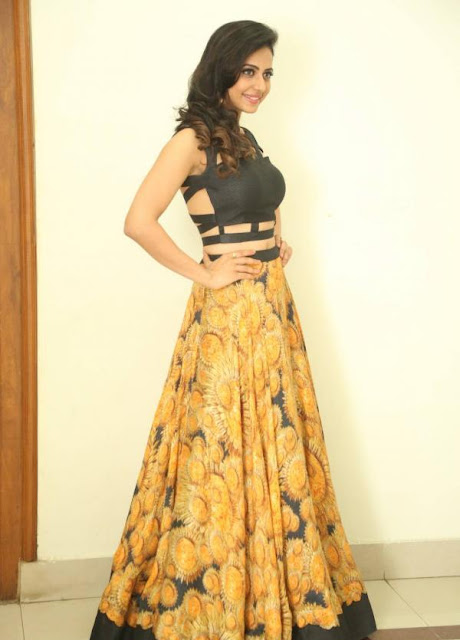 Rakul Preet Singh in Black Crop Top with Zipper Back and Yellow Printed Long Skirt