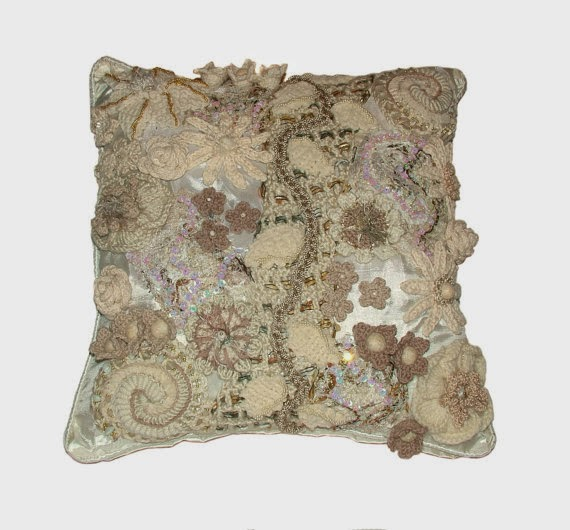 http://www.etsy.com/nz/listing/75884779/white-cream-ooak-floral-cushion-cover