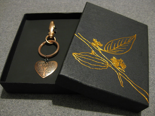 Salt water etched copper heart keyring in box.  Etched using vinyl resists cut by Silhouette Cameo.  Tutorial by Nadine Muir for Silhouette UK Blog