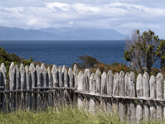 Wooden fence and view of the Strait of Magellan at Fort Bulnes near Punta Arenas Chile
