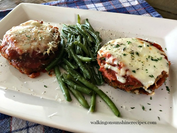 Healthy Baked Eggplant Parmesan with green beans on white platter from Walking on Sunshine