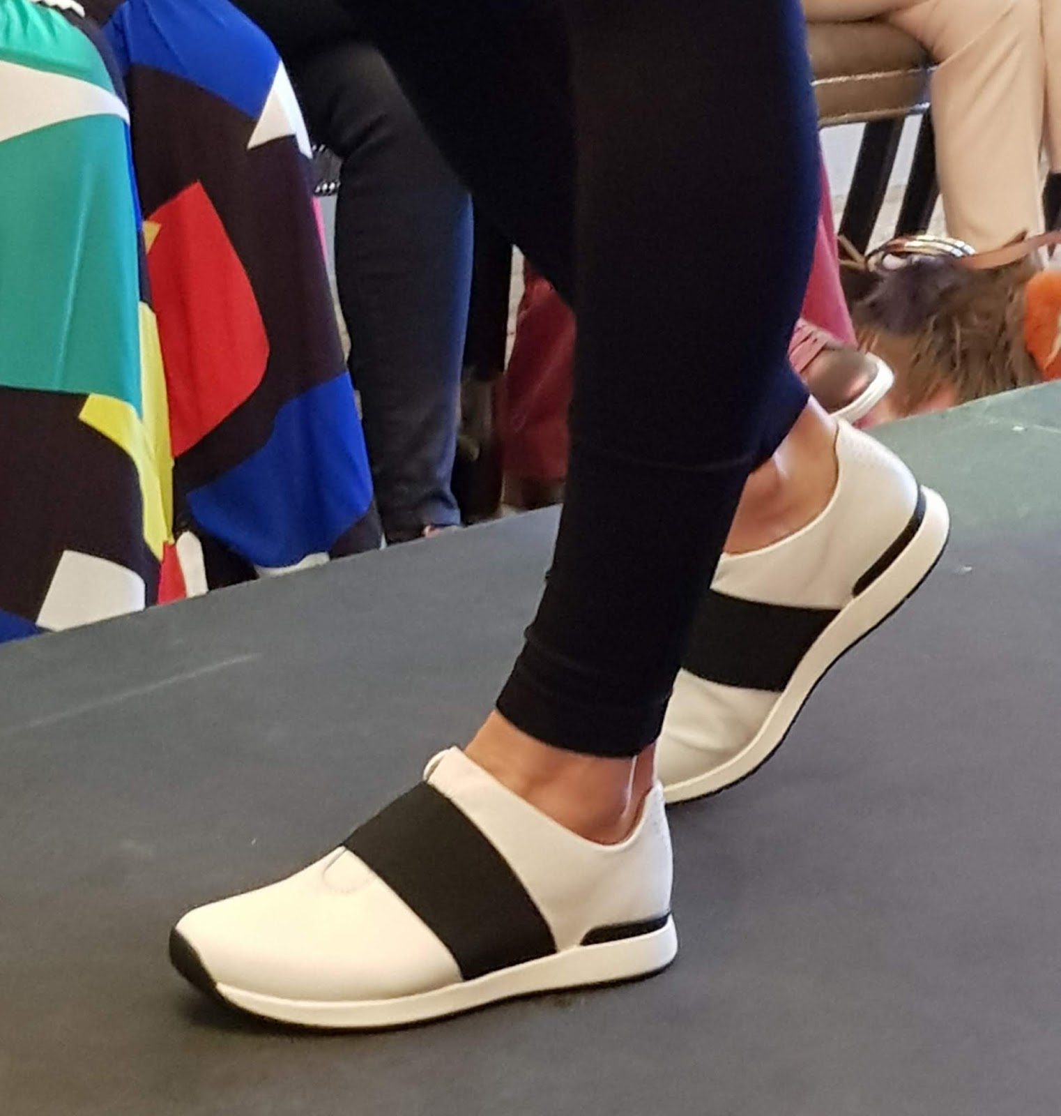 A model showing the Vionic Codie slip-on shoe in white