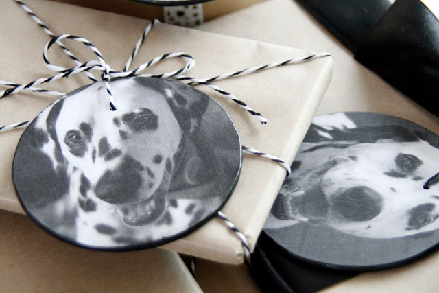 Pet photograph gift tags on wrapped brown paper presents with black and white ribbons