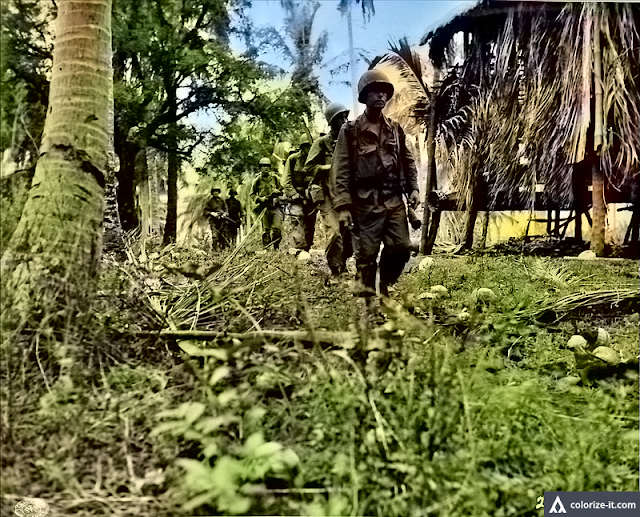 Soldiers of Company G of the 11th Airborne Division enter Barrio Sulok, 1945.  Image source:  United States National Archives.