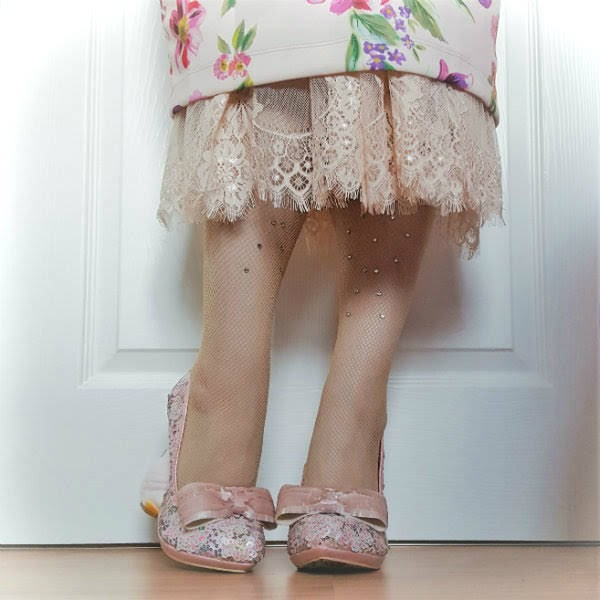 wearing pink bow shoes with nude jewel fishnet tights and lace trim hem skirt