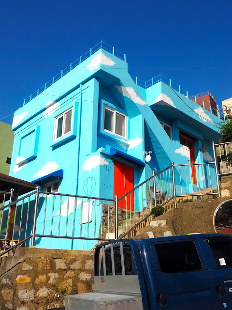 Building painted sky blue with clouds in Gamcheon Village, Busan, South Korea