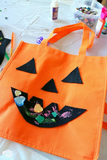 Easy Halloween Party Ideas - make a trick or treat bag! Click through for tons of other ideas for Halloween games and activities.