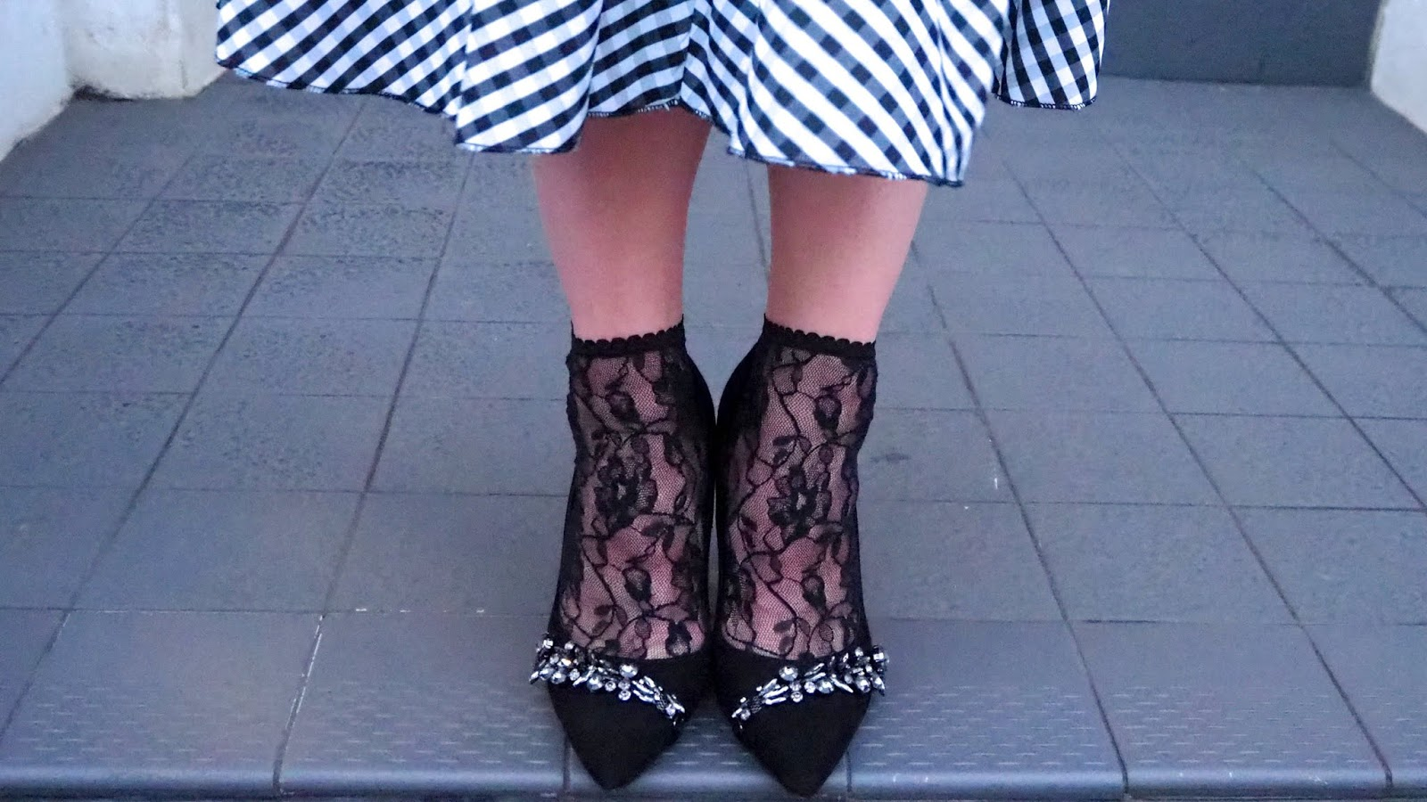 gingham tiered skirt with lace socks and black heels with jewels on them