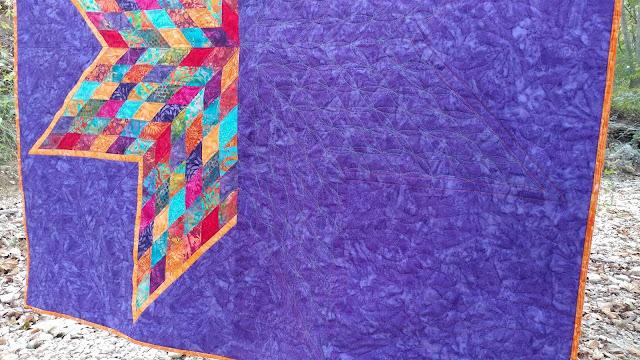 Scrappy Lonestar quilt using Empress Garden fabrics by Island Batik